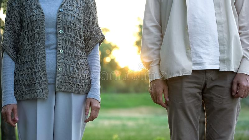 Senior couple standing apart, medical insurance of elderly people, opinion poll royalty free stock photo