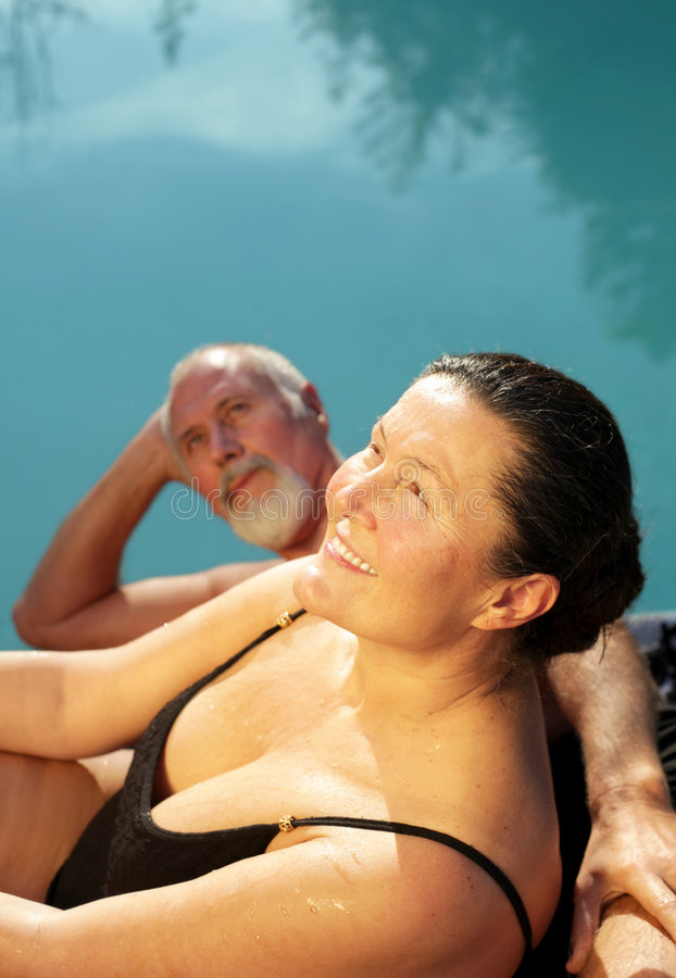 Senior couple on a swim outing stock image