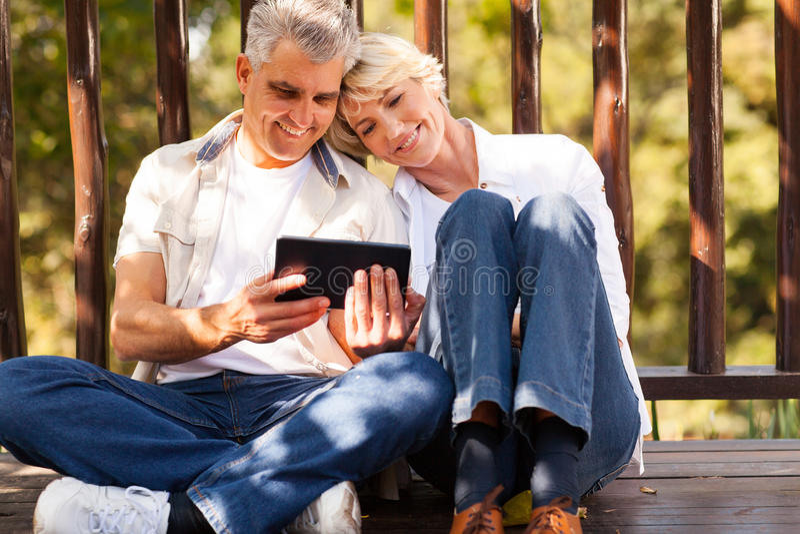 Senior couple tablet stock photos