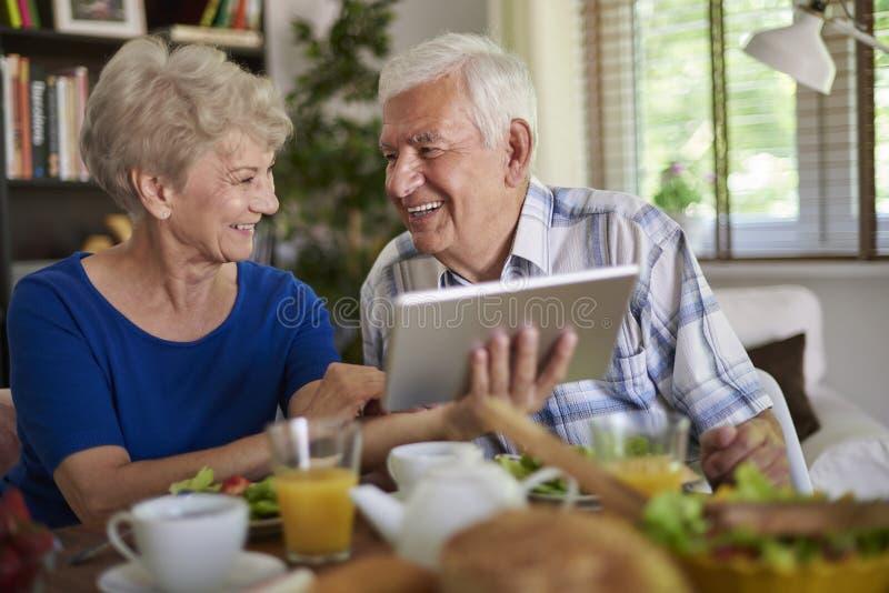 Senior couple with tablet stock photos