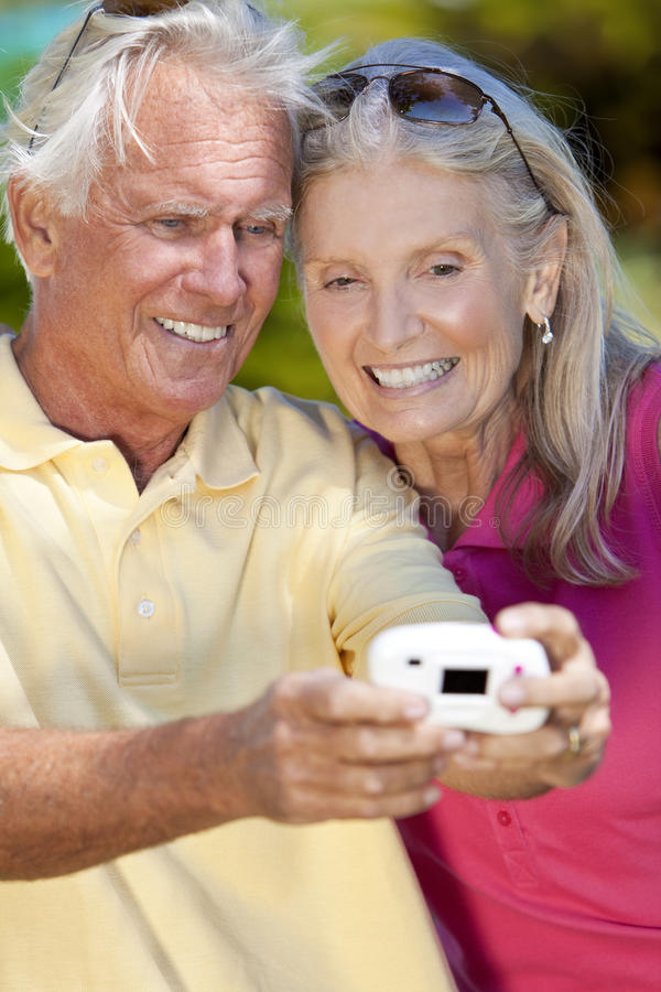 Senior Couple Taking Photograph Digital Camer royalty free stock photos