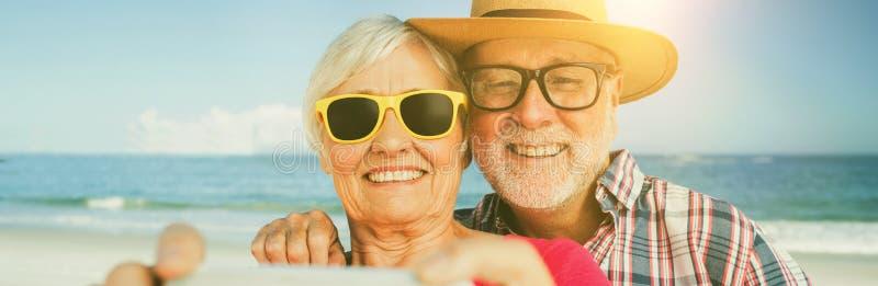 Senior couple taking selfie stock illustration