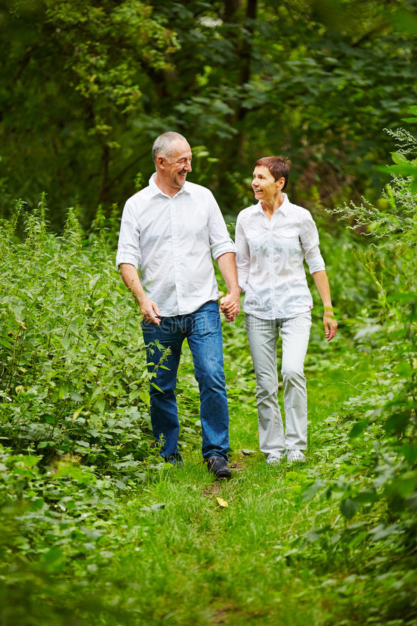 Senior couple taking a walk in nature stock photos