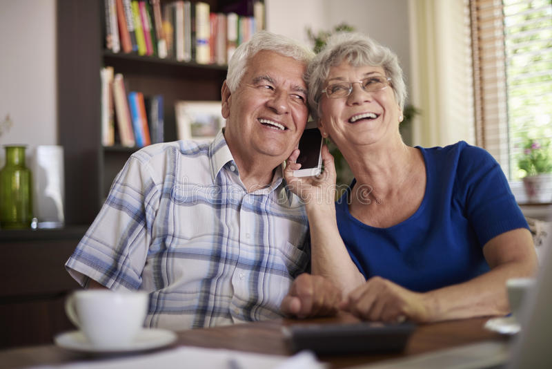 Senior couple talking on the phone stock image