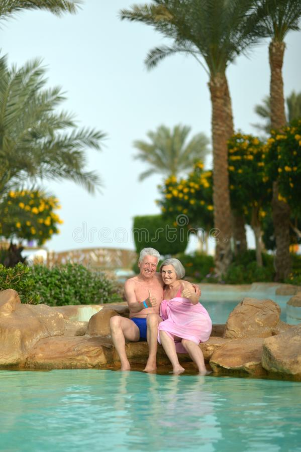 Senior couple at tropic hotel resort. Near pool stock image