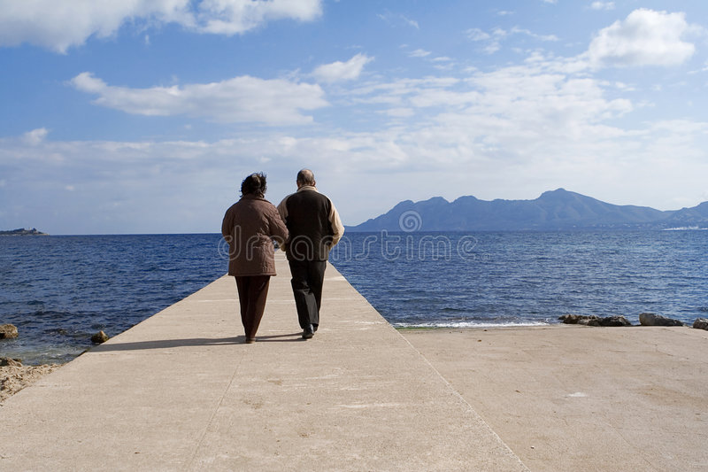 Senior couple on vacation. Active senior couple strolling on vacation royalty free stock photography