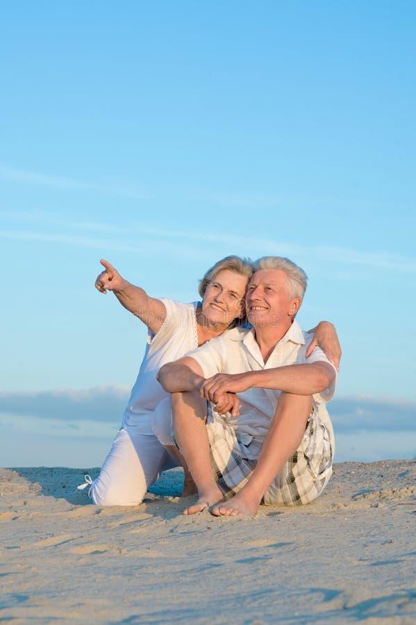 Senior couple on vacation. Portrait of amusing senior couple on vacation royalty free stock images