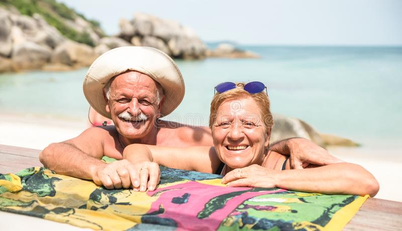 Senior couple vacationer having genuine fun on Koh Samui tropical beach in Thailand - Excursion tour in exotic scenario. Active elderly and travel concept royalty free stock image