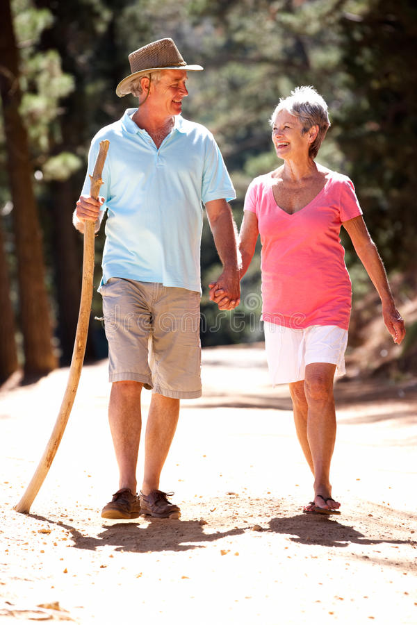 Senior couple walking along a country road royalty free stock image