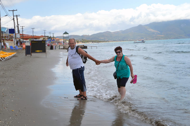 Senior couple walking on beach stock photos