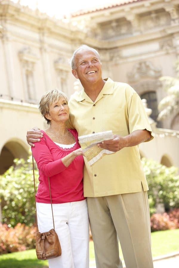 Senior Couple Walking Through City Street royalty free stock photo