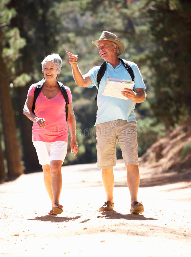 Senior couple walking in country royalty free stock photography