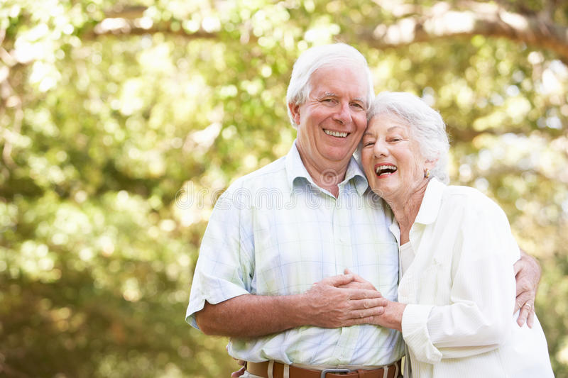 Senior Couple Walking In Park royalty free stock images