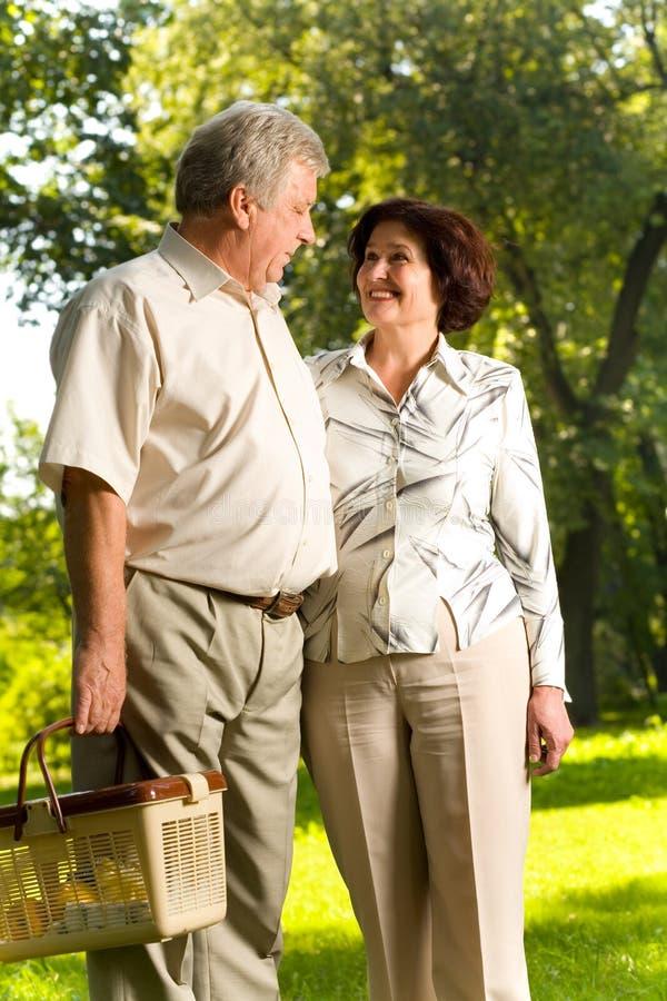 Senior couple walking in park royalty free stock image