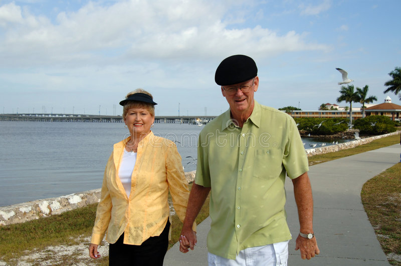 Senior Couple Walking In Park Royalty Free Stock Photos