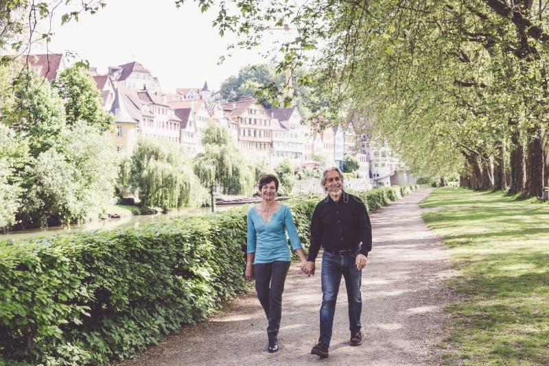 Senior Couple Walking Through A Park stock photos