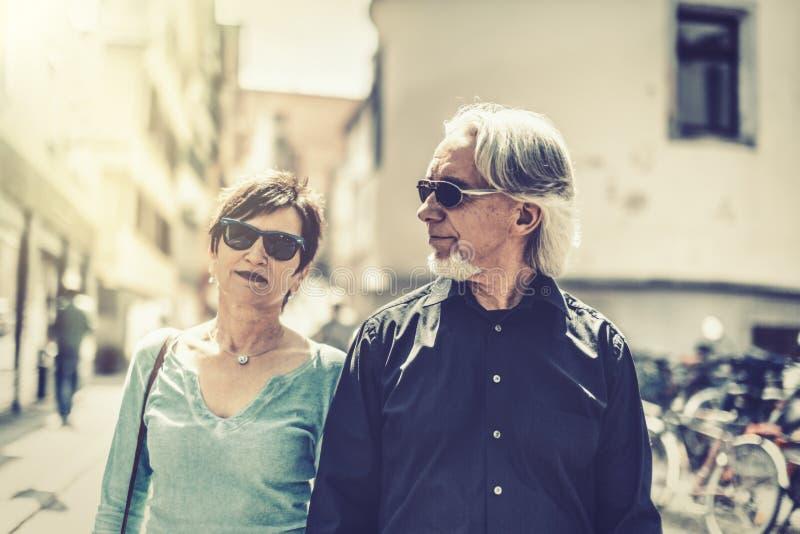 Senior Couple Walking Through The Streets Of Tuebingen royalty free stock photos