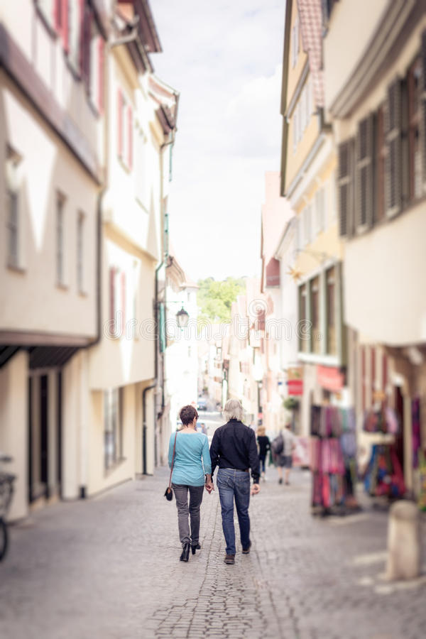 Senior Couple Walking Through Tuebingen royalty free stock photos