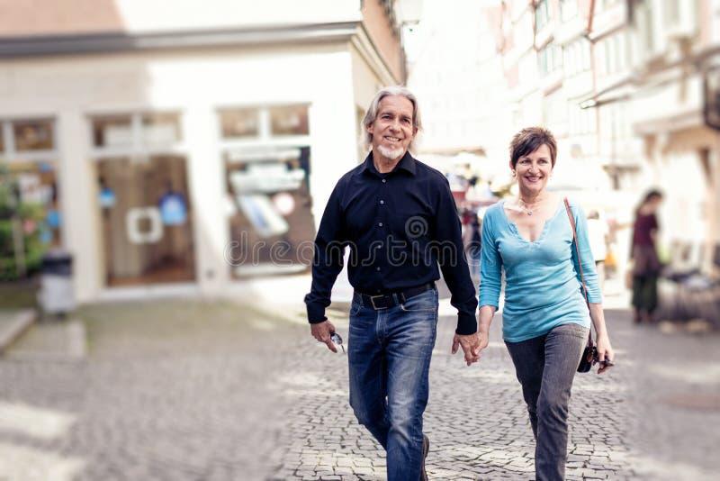 Senior Couple Walking Through Tuebingen royalty free stock images