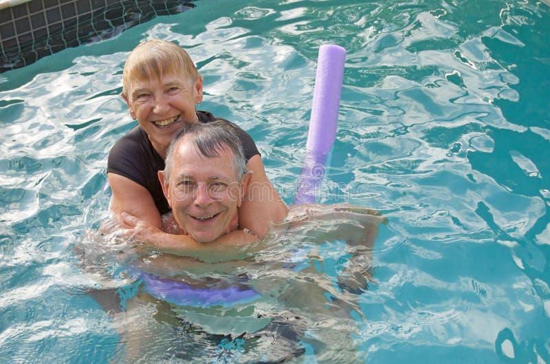 Senior couple water fun royalty free stock image