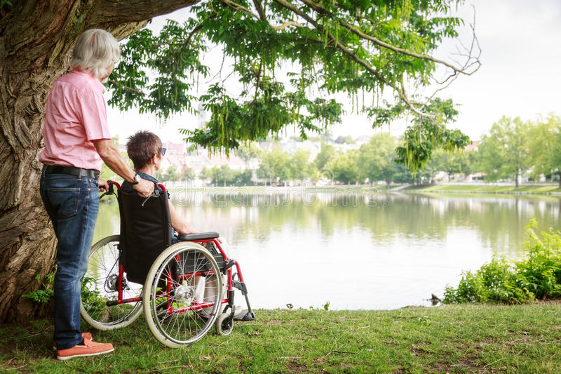 Senior Couple In Wheelchair stock photo