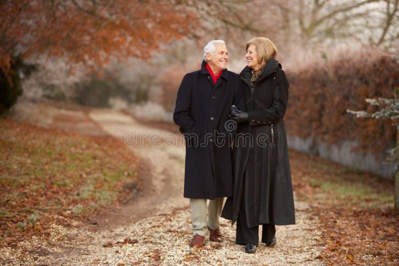 Senior Couple On Winter Walk Through Frosty Landsc Royalty Free Stock Images