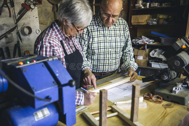 Senior couple in a carpentry royalty free stock images