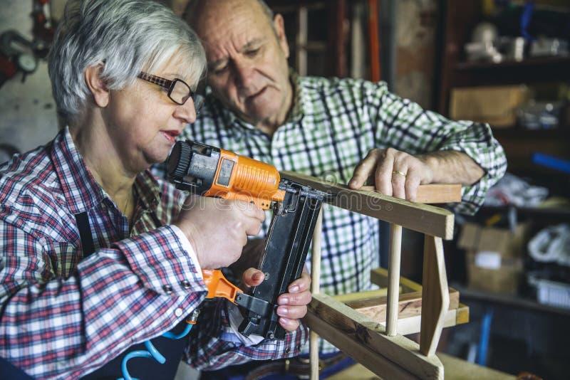 Senior couple in a carpentry royalty free stock photos