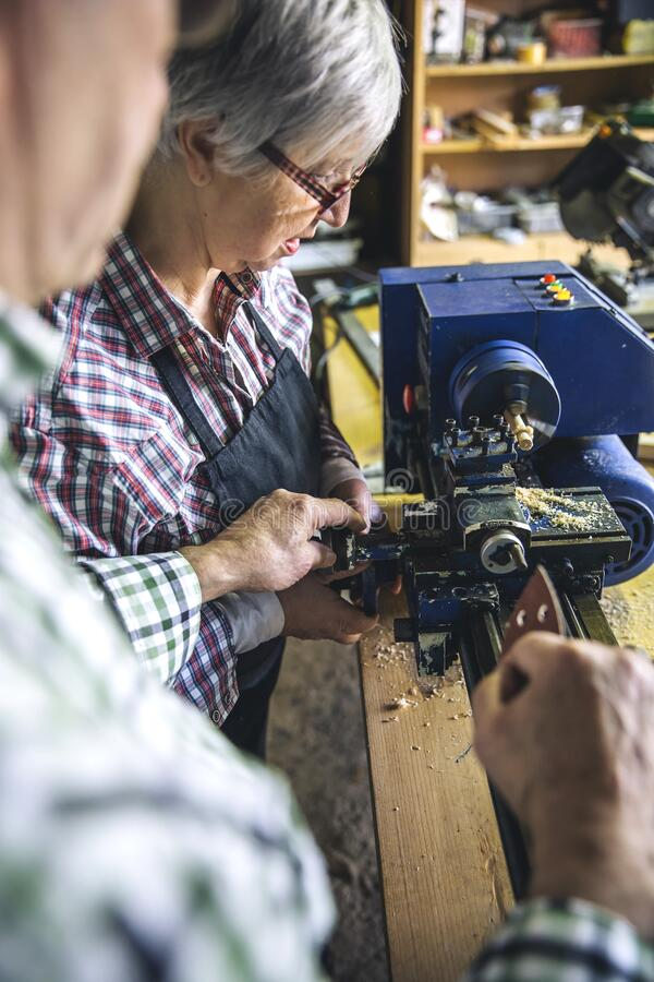 Senior couple in a carpentry royalty free stock photo