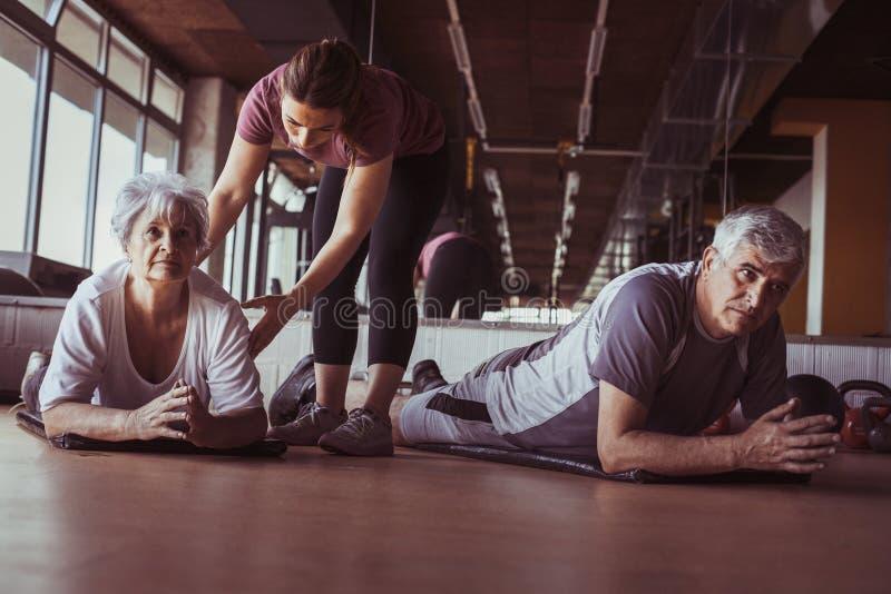 Senior couple workout in rehabilitation center. stock images