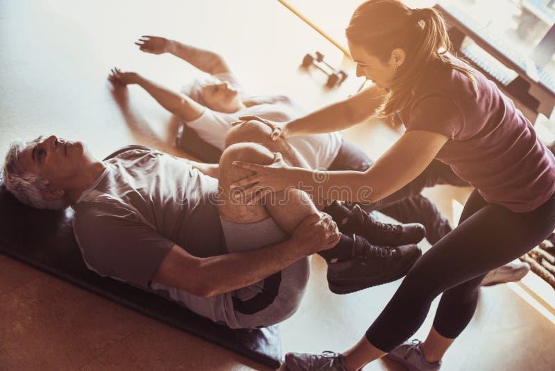 Senior couple workout in rehabilitation center. royalty free stock photos