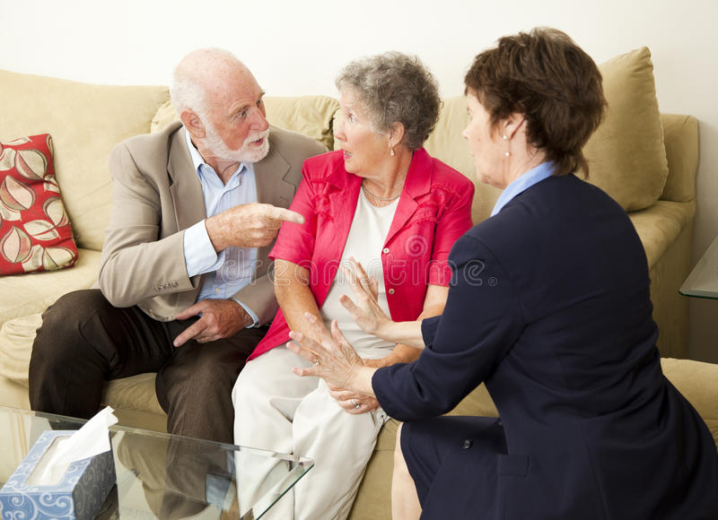 Senior Couples Counseling. Senior couple in therapy, working out their problems with a counselor stock images