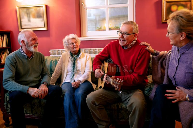 Senior couples enjoying in the good songs of their youth stock photos