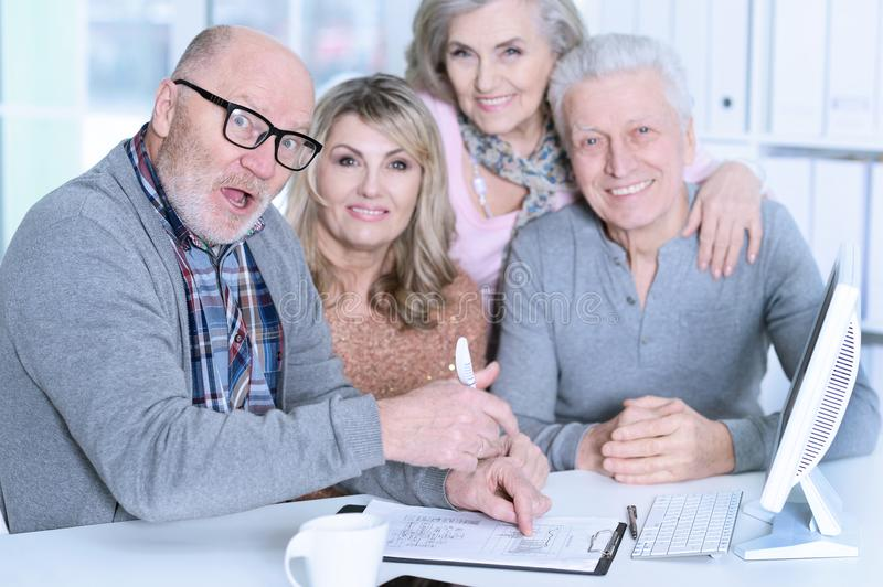 Senior couples playing computer game royalty free stock photo