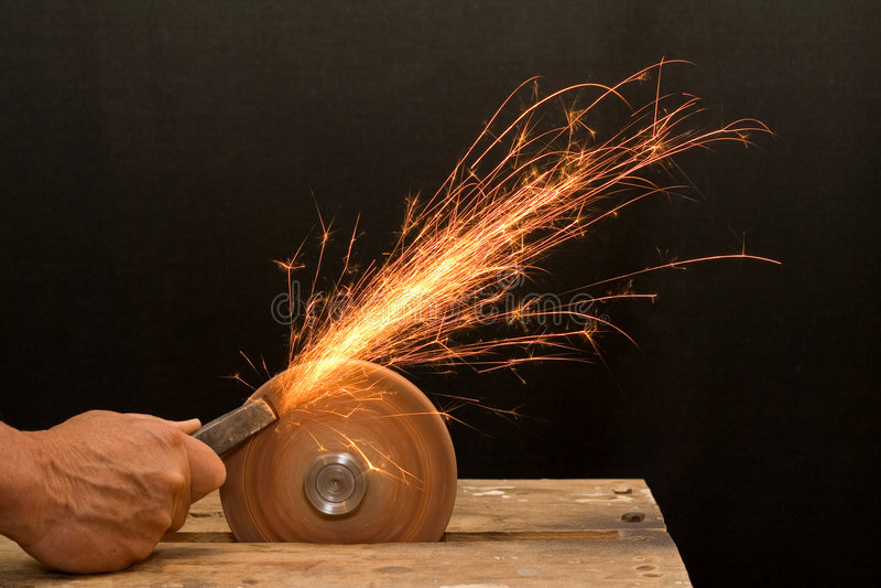 Senior craftsman hand grinding royalty free stock photo