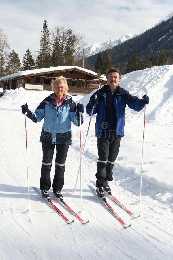 Senior Cross country skiing. A senior couple outdoor in a winter setting. The active couple is about to go crosscountry skiing royalty free stock images
