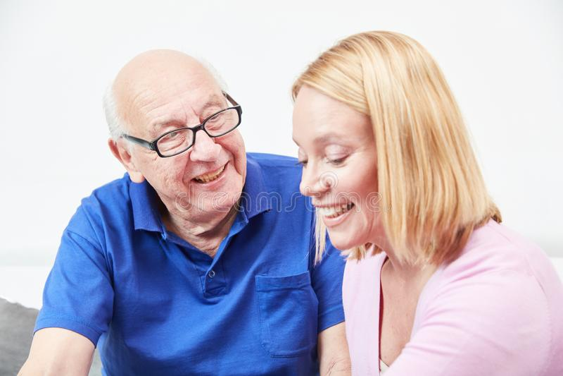 Senior and daughter talking at home royalty free stock photo
