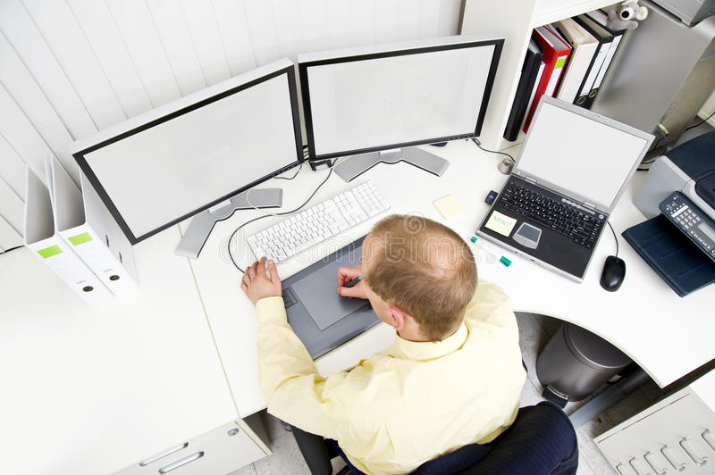 Senior Designer. Using a graphic tablet, at work in an office stock image