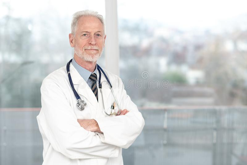 Senior doctor with arms crossed royalty free stock photo