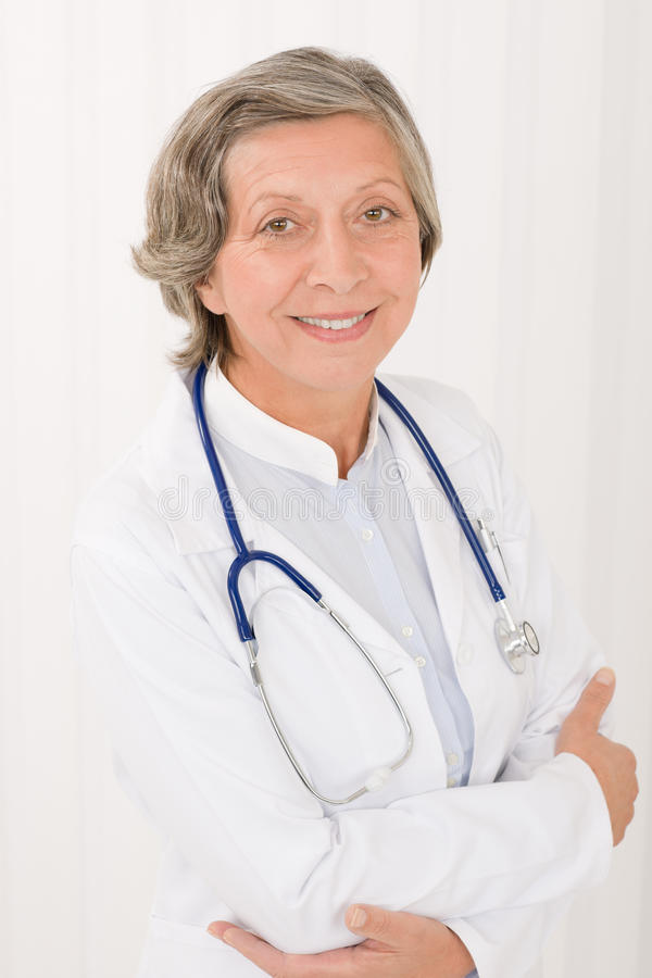 Senior doctor female with stethoscope smiling royalty free stock photo