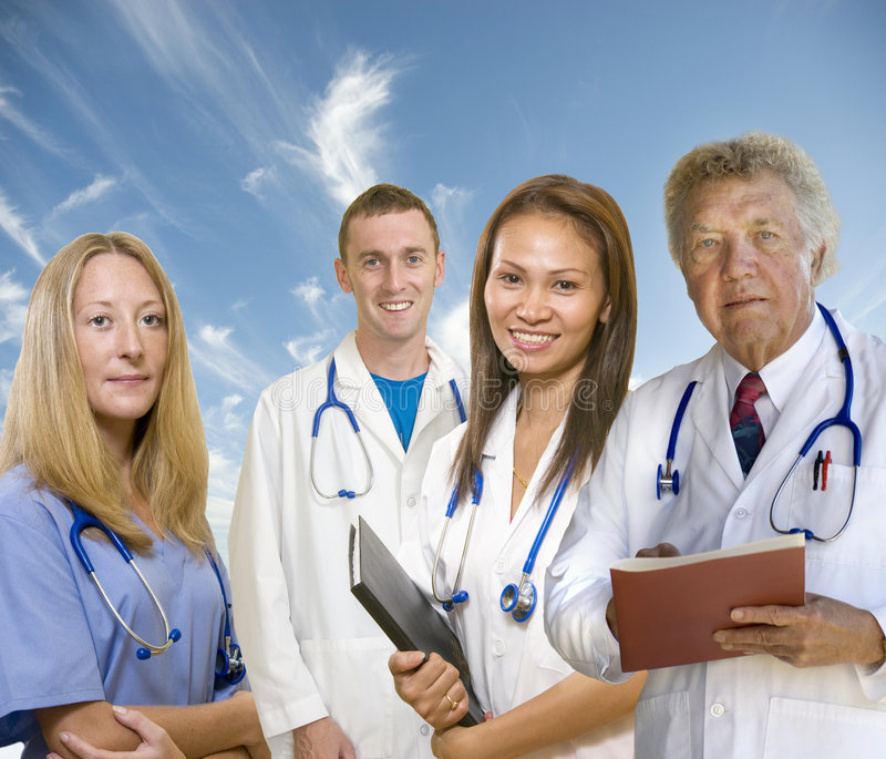 Senior Doctor and his staff royalty free stock photography