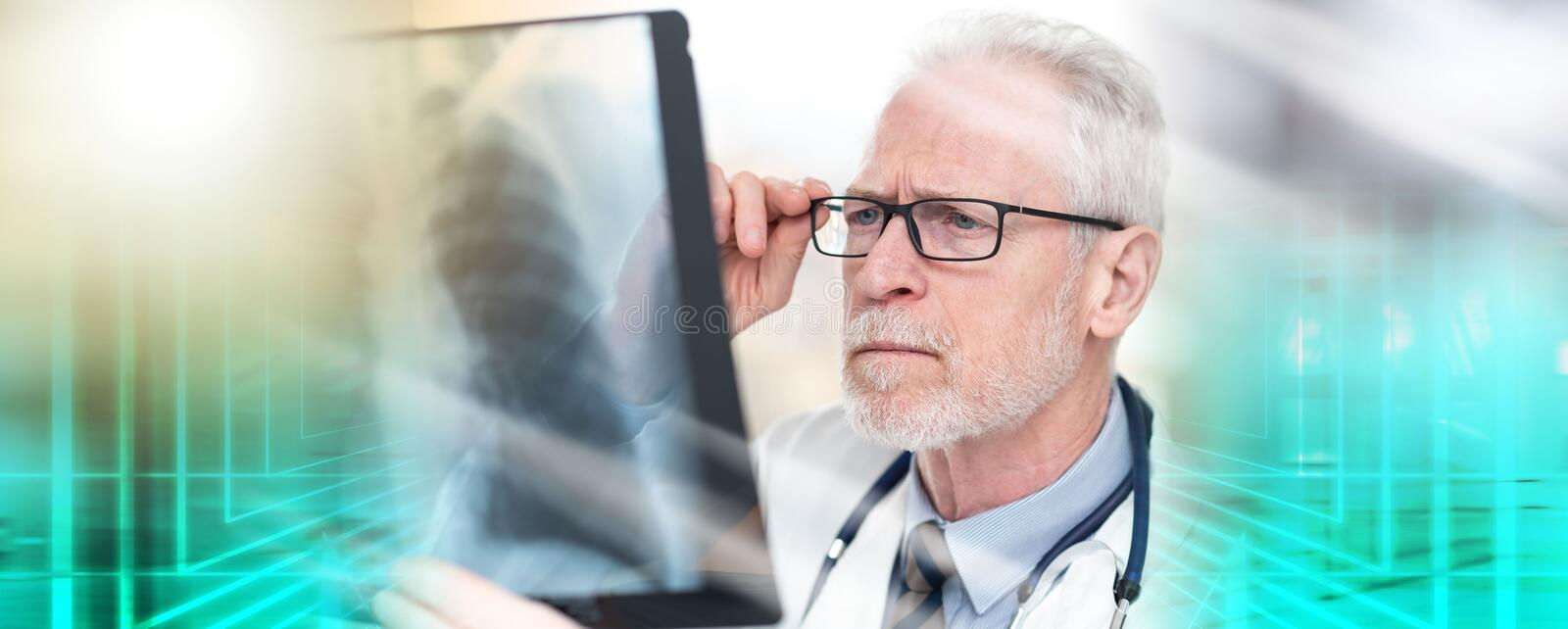 Senior doctor looking at x-ray; multiple exposure. Senior doctor looking at x-ray in clinic; multiple exposure stock images
