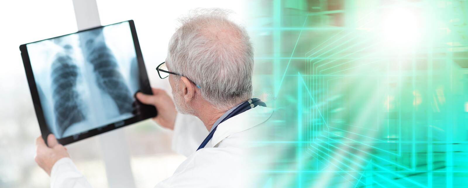 Senior doctor looking at x-ray; multiple exposure. Senior doctor looking at x-ray in clinic; multiple exposure royalty free stock image