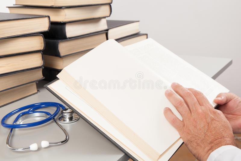 Senior Doctor Reading Medical Books stock photography