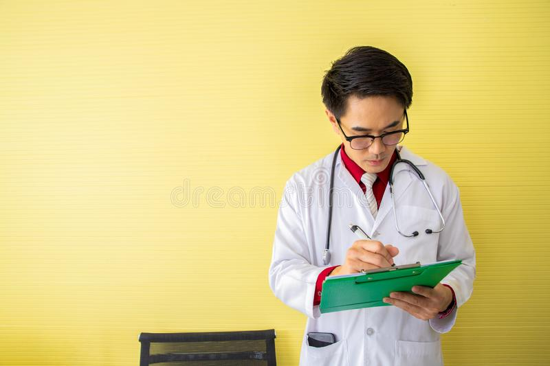 Senior doctor reading and writing patient profile stock images