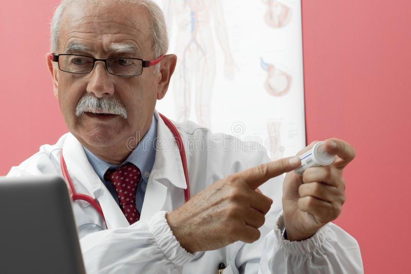 Download Senior Doctor Using Webcam Royalty Free Stock Photos - Image: 16906938