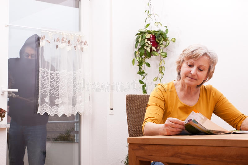 Senior does not note the burglar stock photography