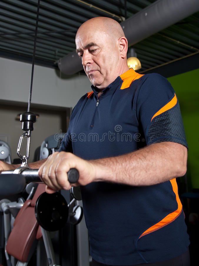 Senior Doing Triceps Exercises Stock Photography