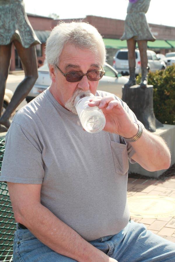 Senior drinking water royalty free stock photography