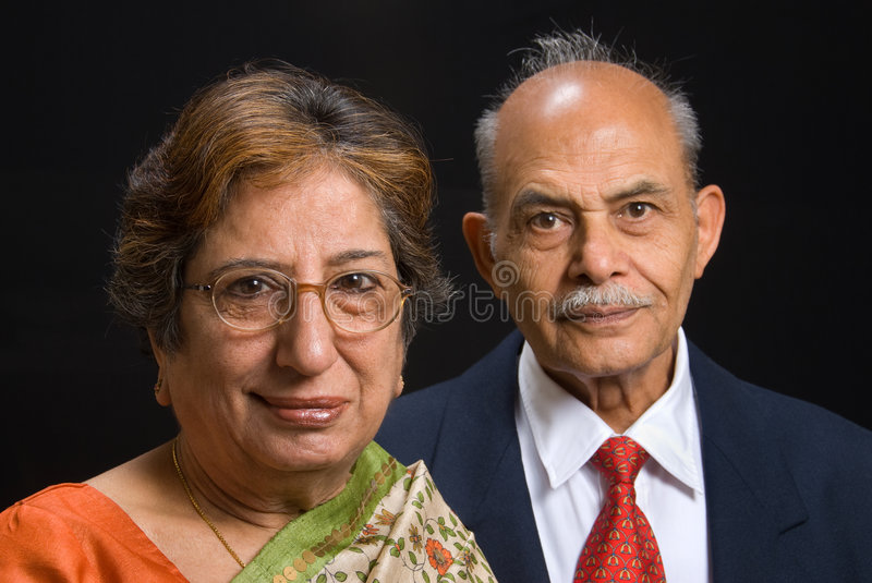 Senior East Indian couple. A portrait of an elegant senior East Indian couple royalty free stock images